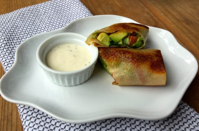 Recipe for low carb avocado spring rolls full of fresh ingredients.
