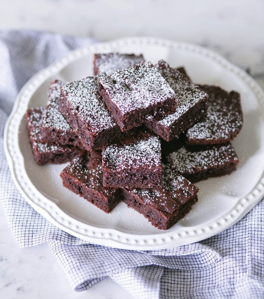 A recipe for delicious and simple keto brownies made with cocoa powder and chocolate chips.