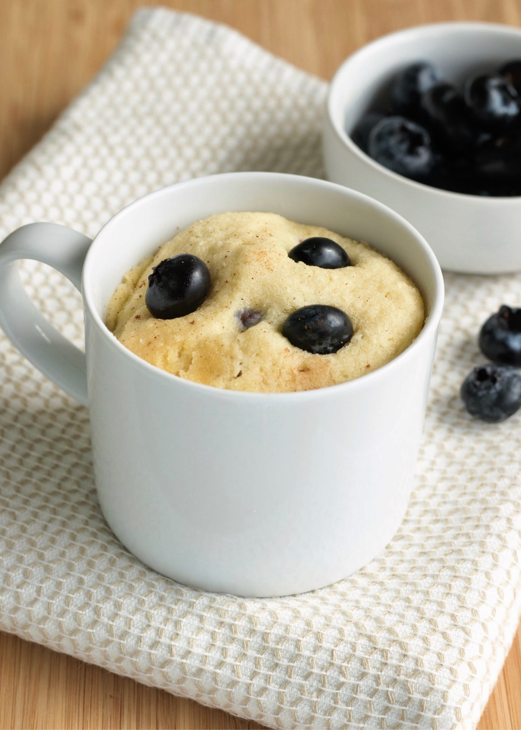 Keto blueberry muffin recipe that you make in a mug.