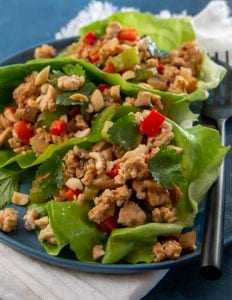 Recipe for keto asian lettuce wraps that are a copycat recipe of PF Chang's Chicken Lettuce Wraps.