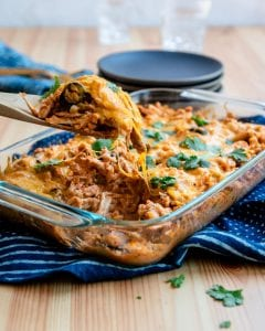Have a hearty dinner on the table in just about 30 minutes with this easy chicken enchilada casserole recipe!