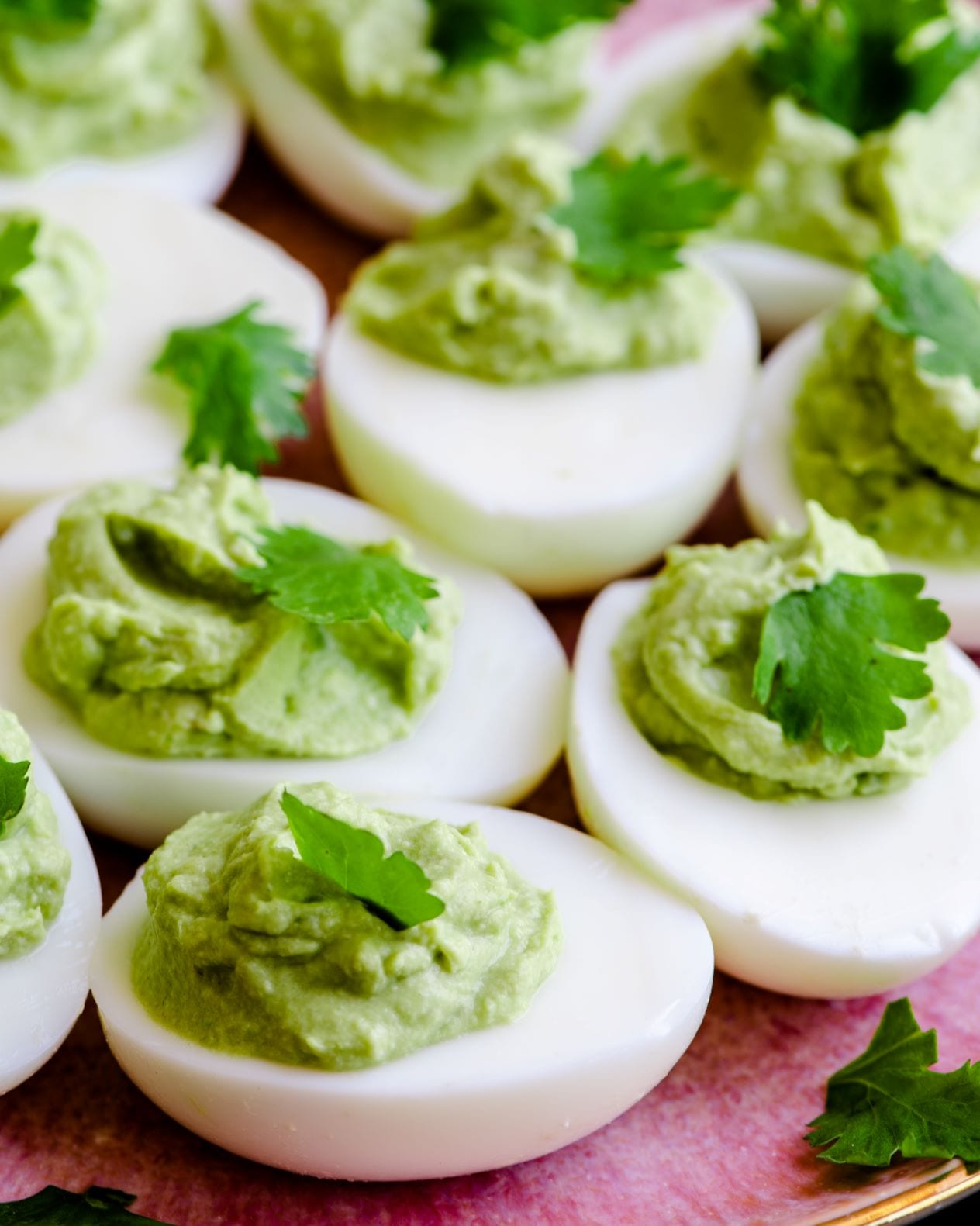 Recipe for avocado lime deviled eggs - a fun twist on traditional deviled eggs.